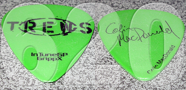 Colin's green guitar pick, front and back.