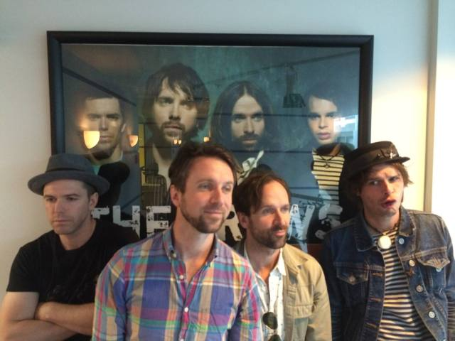 Throwback Thursday - the band posing in front of a poster from 2005/6